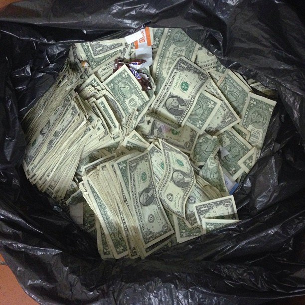money in trash bag